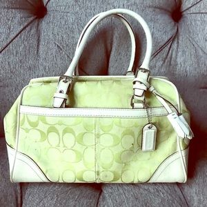 Green and white coach bag